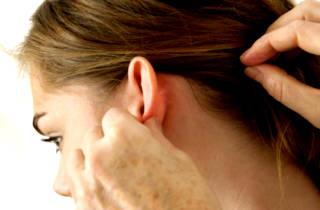 Опухоль за ухом